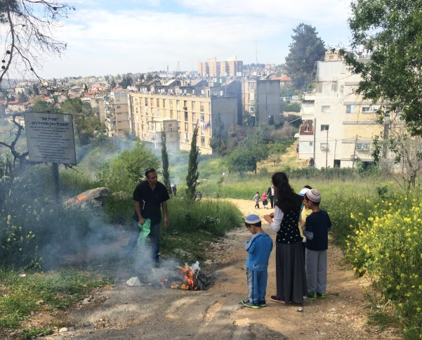 A family burns bread in Jerusalem at the start of Passover
