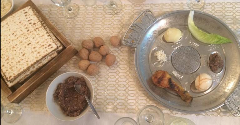 Our Passover Seder dinner table - symbolic foods include matzah, hardboiled egg, horseradish, wine, charoset sw